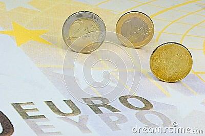 Euro-coins on Euro-banknote