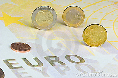 Euro-coins on Euro-banknote
