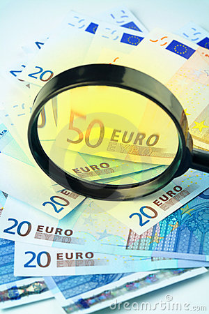 Euro currency under a magnifying glass