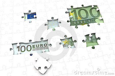 Euro money bill under jigsaw puzzle