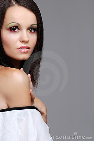 European brunette woman wearing a white top