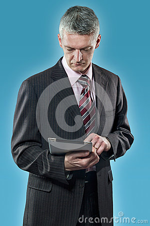 European businessman with digital tablet