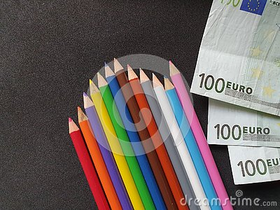 European money and color pencils on the black background Stock Photo