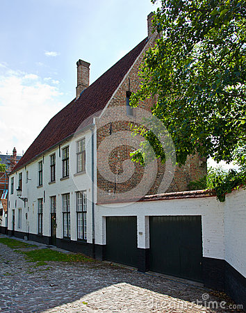 European small street with old brick houses in a bright sunny da royalty free stock photo - Small belgian houses brick ...