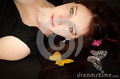 European woman with butterflies on the hair