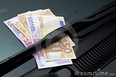 Euros under windshield wiper