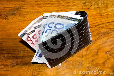 Euros in  wallet, on vintage brown backgroun