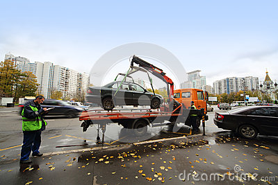 Evacuation vehicle for traffic violations at the entrance to the park Editorial Stock Image