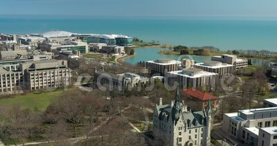 EVANSTON, IL - APRIL 3, 2020: On a normally busy school day, an aerial view shows the campus of Northwestern University shut down stock video footage