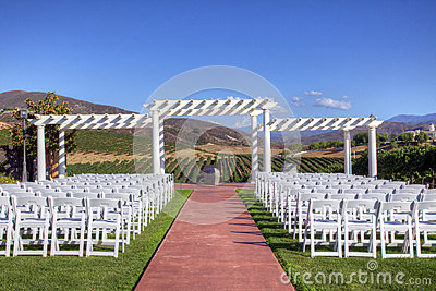 Event Venue with White Folding Chairs