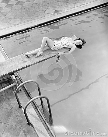 Free Everything S Above Board For Young Woman At The Pool Stock Photography - 52014012