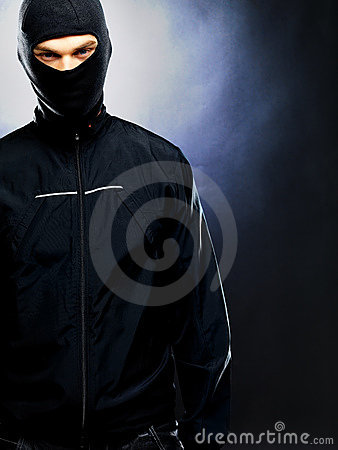 Evil male criminal wearing balaclava - Copyspace