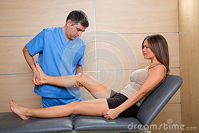 Examination and mobilization of knee joint doctor to woman