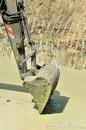 Excavator bucket collecting water