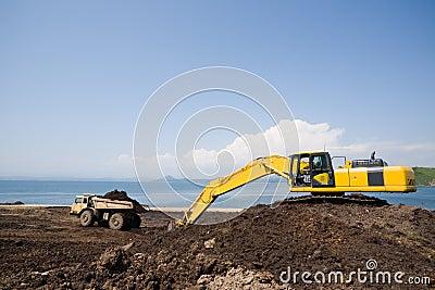 Excavator.dump truck.sea