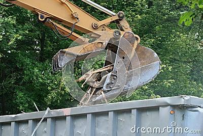 Excavator dumps waste