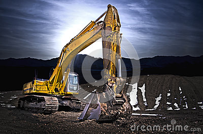 Excavator in gravel mountain