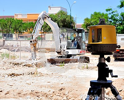 Excavator with hammer demolishes e laser