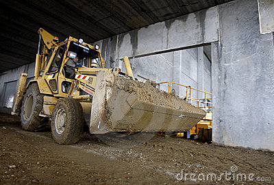 Excavator inside industrial building in progress Editorial Stock Photo