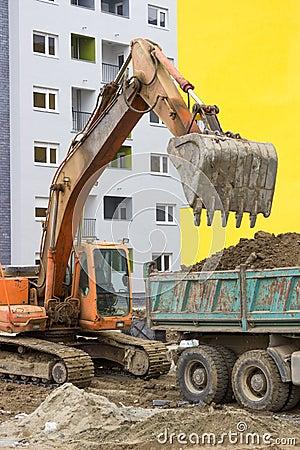 Excavator loading dumper truck 3