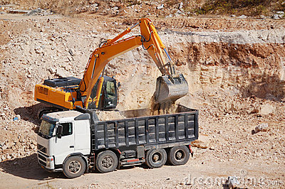 Excavator loading dumper truck with sand
