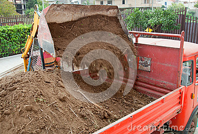 Excavator loading truck shot
