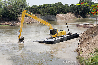Excavator machine  works at river