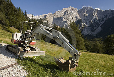 Excavator in the mountains