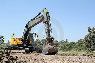 Excavator on road construction