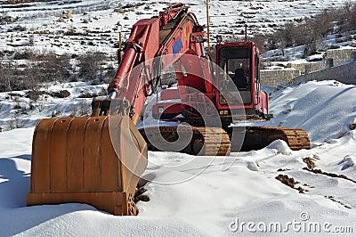 Excavator on snow