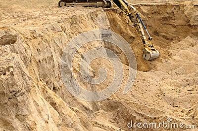 Excavator trenching.