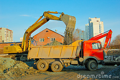 Excavator and truck move earth