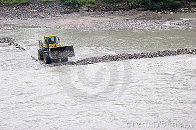 Excavator working in a river
