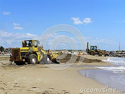 Excavators repairing a beach