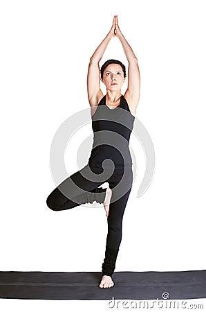 Excercising yoga pose vrikshasana
