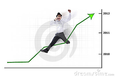 Excited Asian businessman jumping with chart