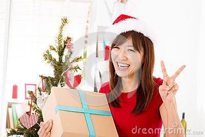 Excited Asian getting her Christmas present