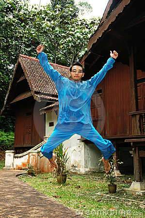 Excited Asian Muslim Male in Traditional Costume
