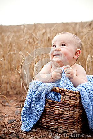 Excited baby in basket