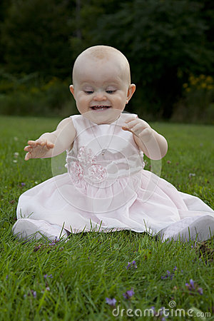 Excited baby discovers grass