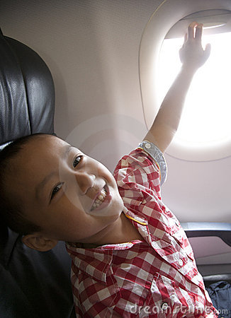 Excited boy in an airplane
