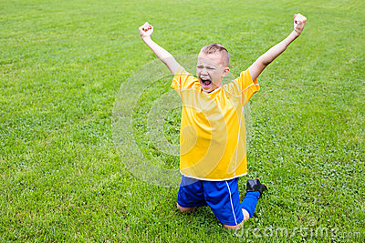 Excited boy football player