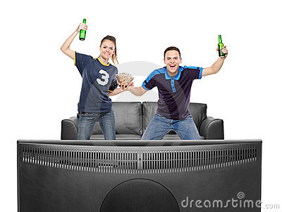 Excited boy and girl watching sport on a TV