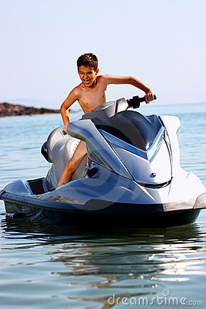 Excited boy on jet ski