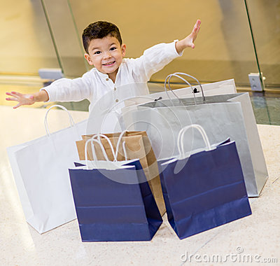 Excited shopping boy