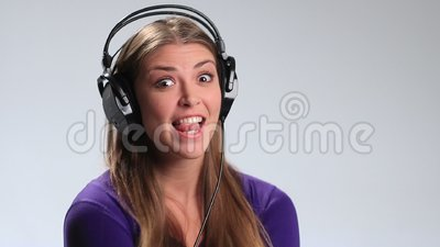 Excited brunette girl in headphones enjoying music stock footage