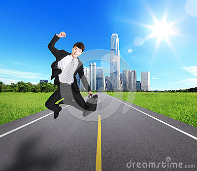 Excited Business man jump and run