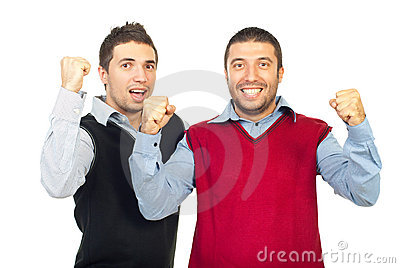 Excited business men raising hands