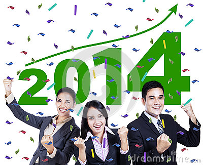 Excited business people celebrating a new year 2014
