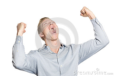 Successful businessman shouting his achievement.